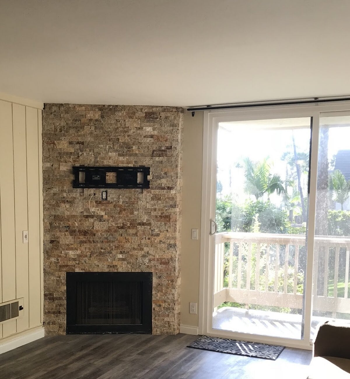 Stone fireplace installation in Carlsbad, CA from Savon Flooring
