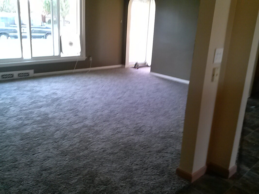 Gray tone carpet installation in Gibraltar, MI from Floorz by Bill