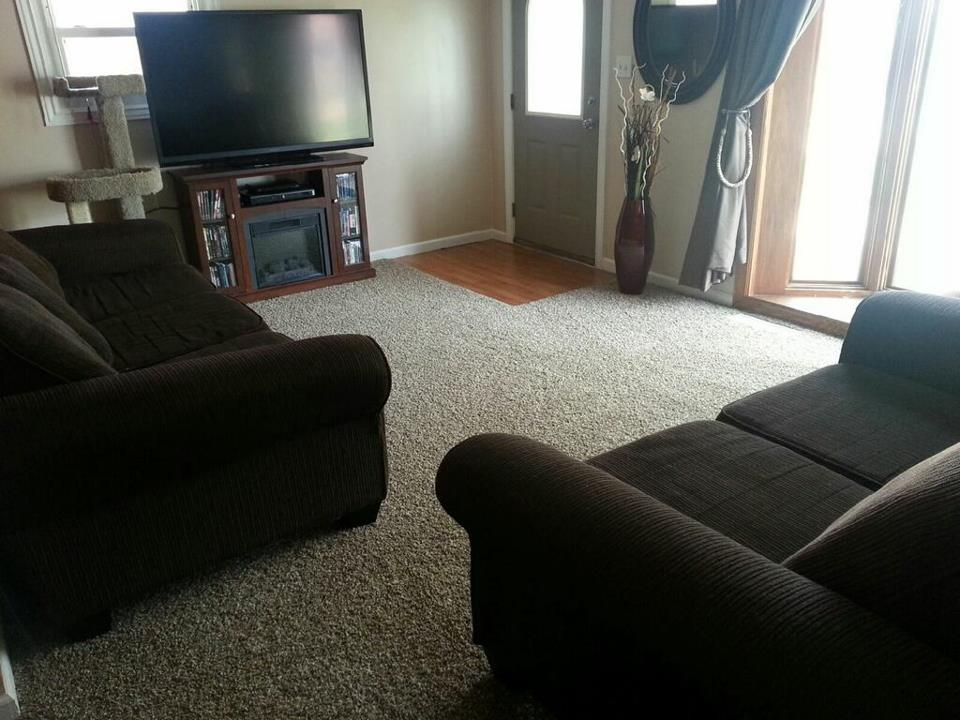 New carpet flooring with hardwood entryway in Brownstown, MI