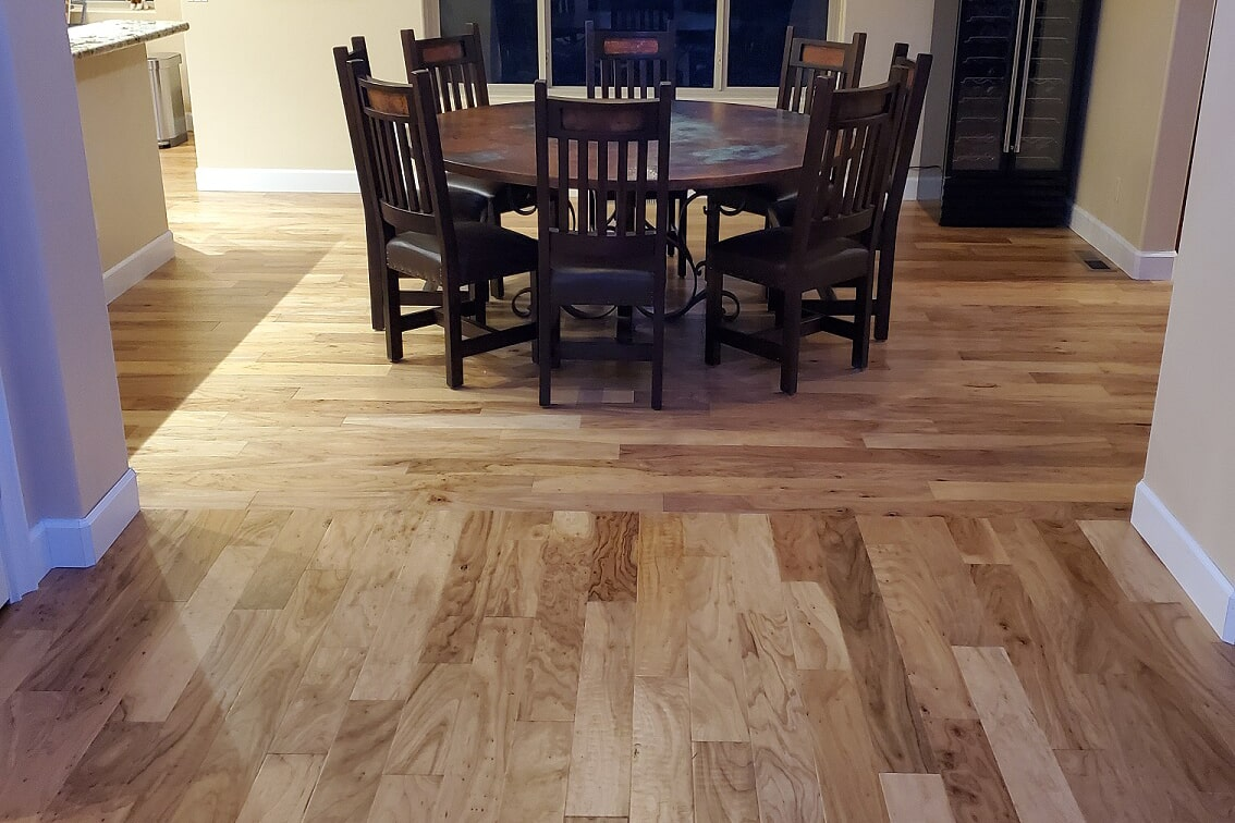 Wood floor dining area in Chino Valley, AZ from Prescott Flooring Brokers