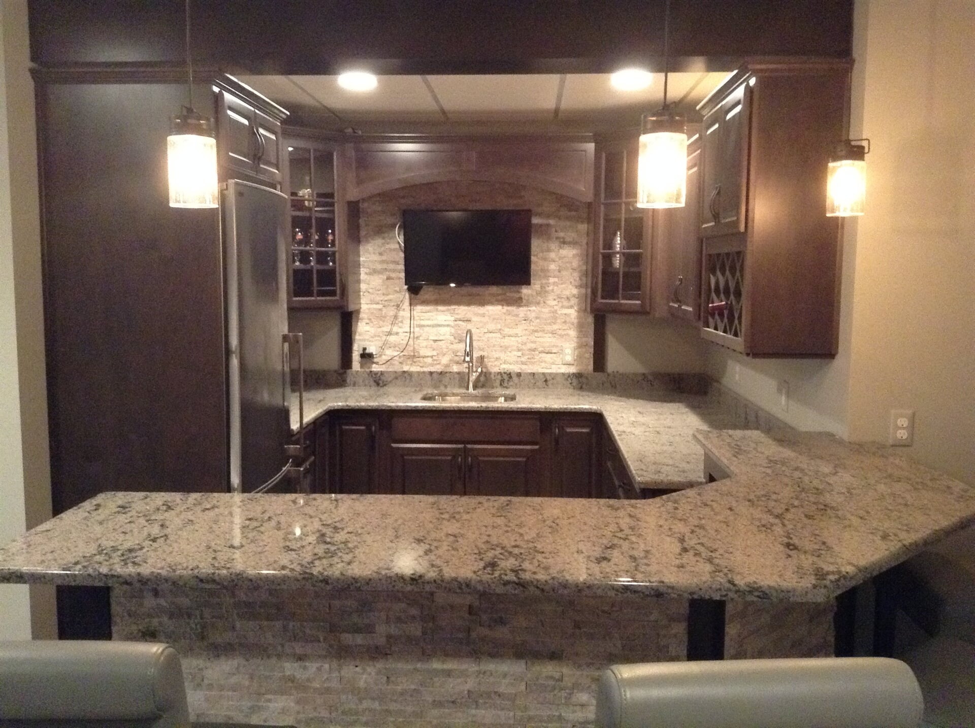 Kitchen countertop installation with tile backsplash and accents in Monroe, MI