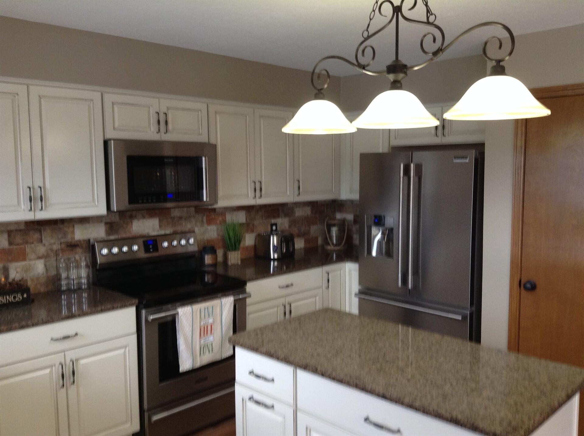 Elegant kitchen remodel with stone backsplash in Flat Rock, MI