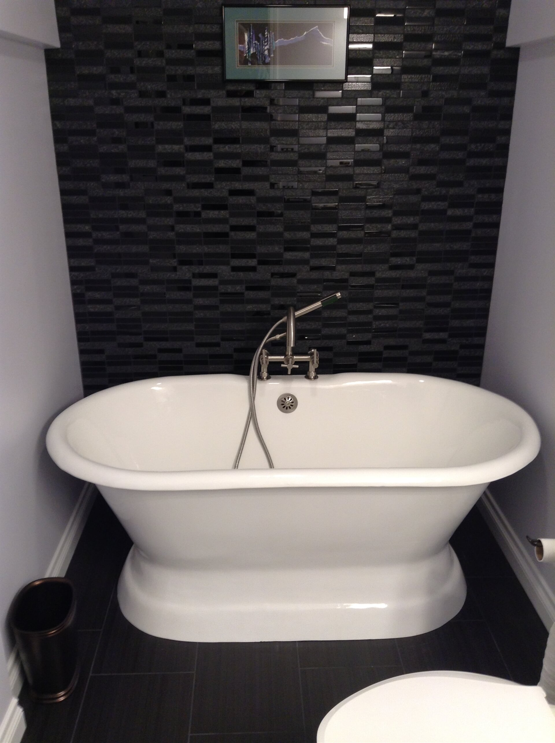 Bathroom remodel with beautiful glass tile accent wall in Woodhaven, MI
