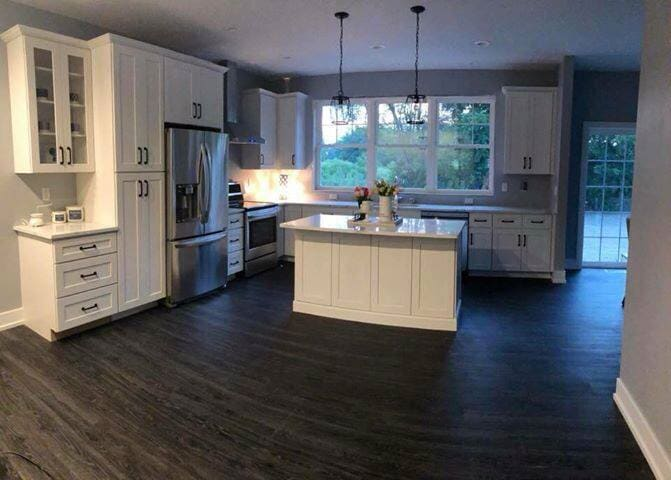 Open space kitchen with flooring remodel in Flat Rock, MI from Finishers Unlimited