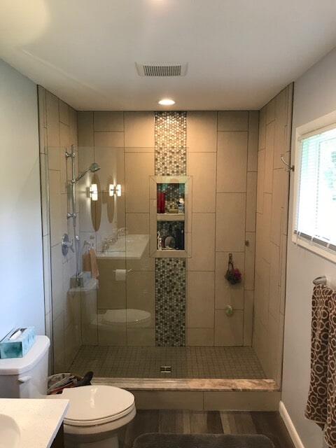 Shower installation with glass tile accent from Finishers Unlimited in Monroe, MI
