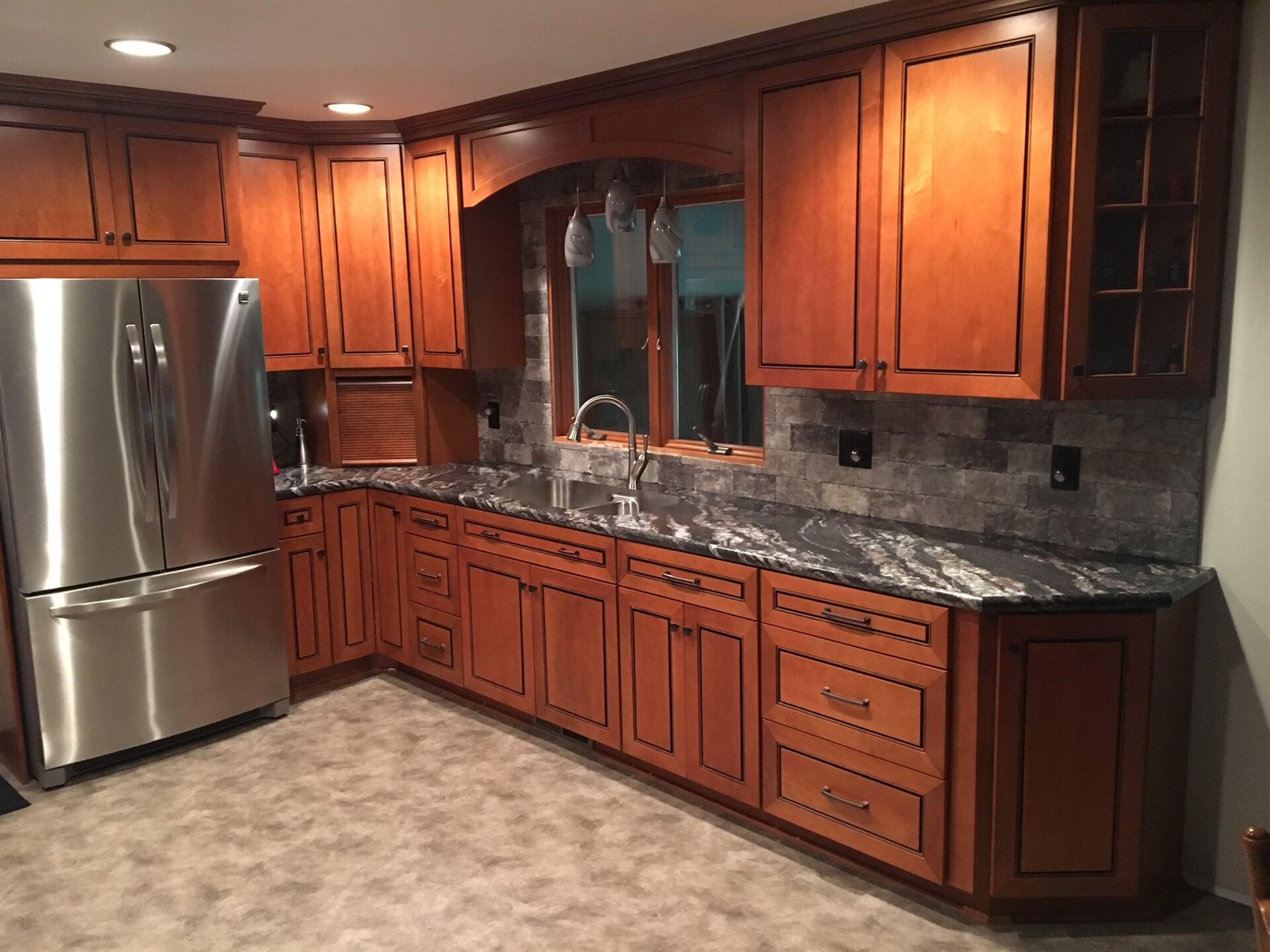 Kitchen remodel with natural granite countertop in Trenton, MI