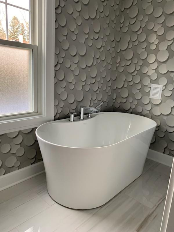 Soaking tub on waterproof flooring in Dundee, MI from Finishers Unlimited