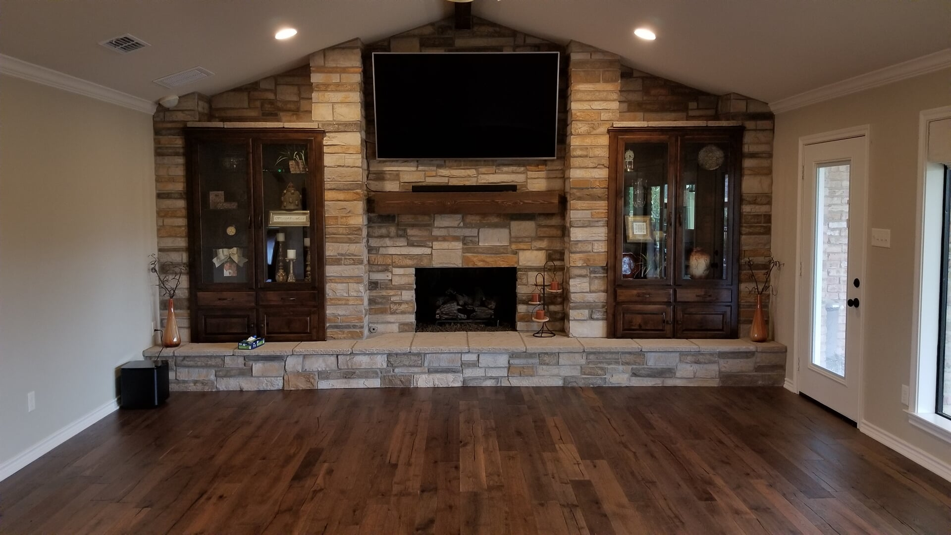 Beautiful built in stone fireplace surround in Tyler, TX from East Texas Floors