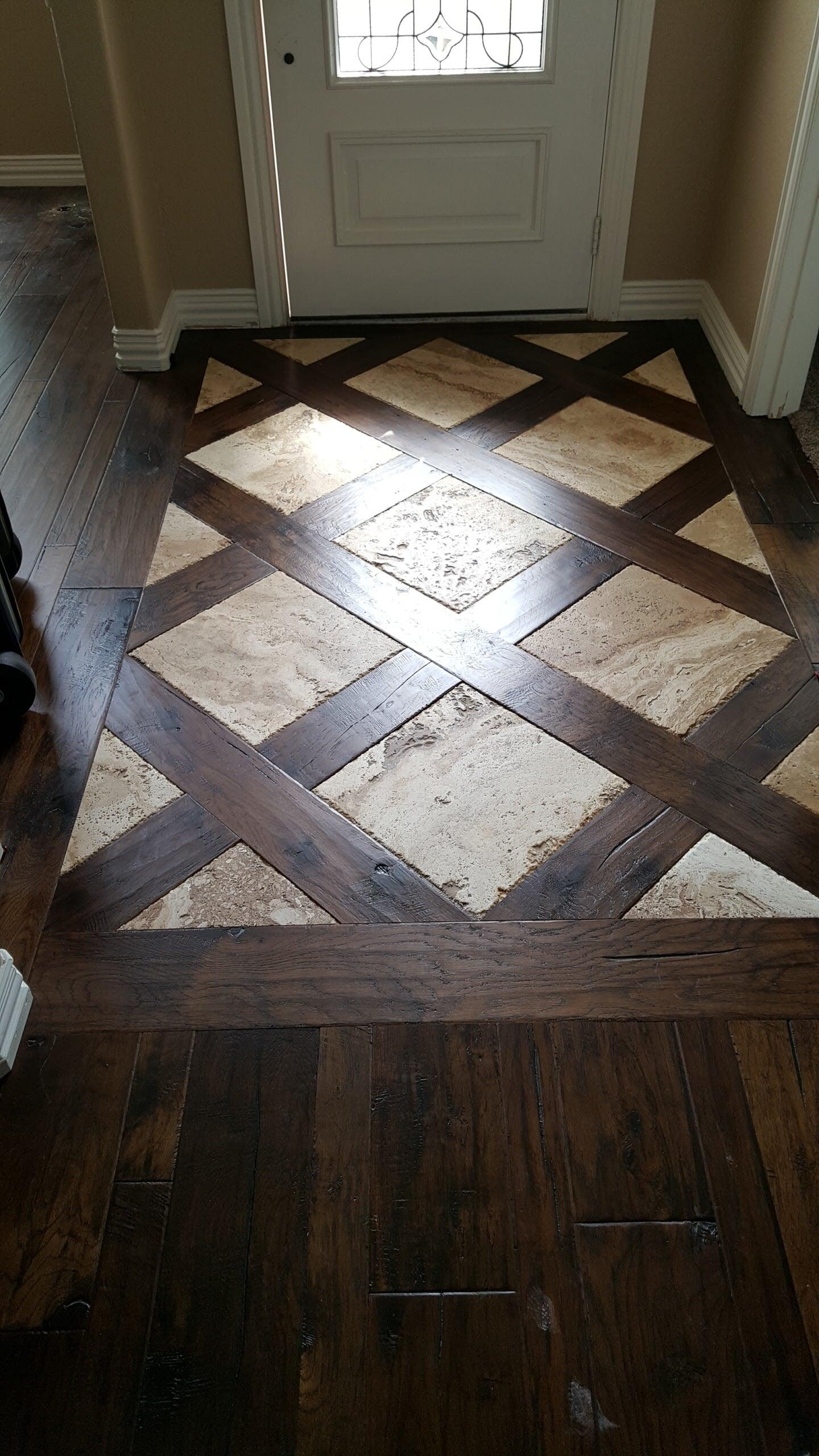 Custom wood and stone flooring entryway in Bullard, TX from East Texas Floors