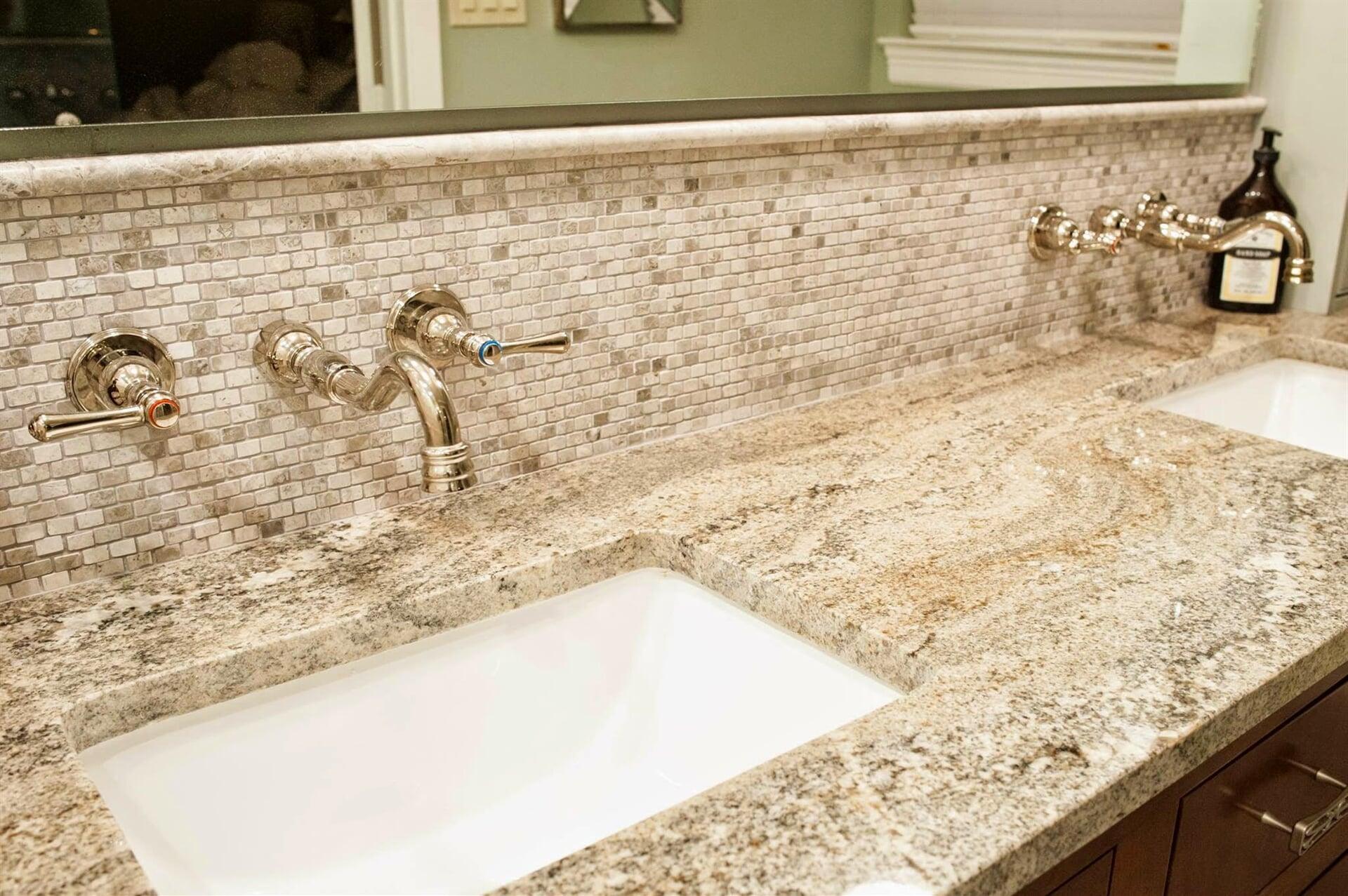 Beautiful dual vanities with custom faucets in Jacksonville, TX