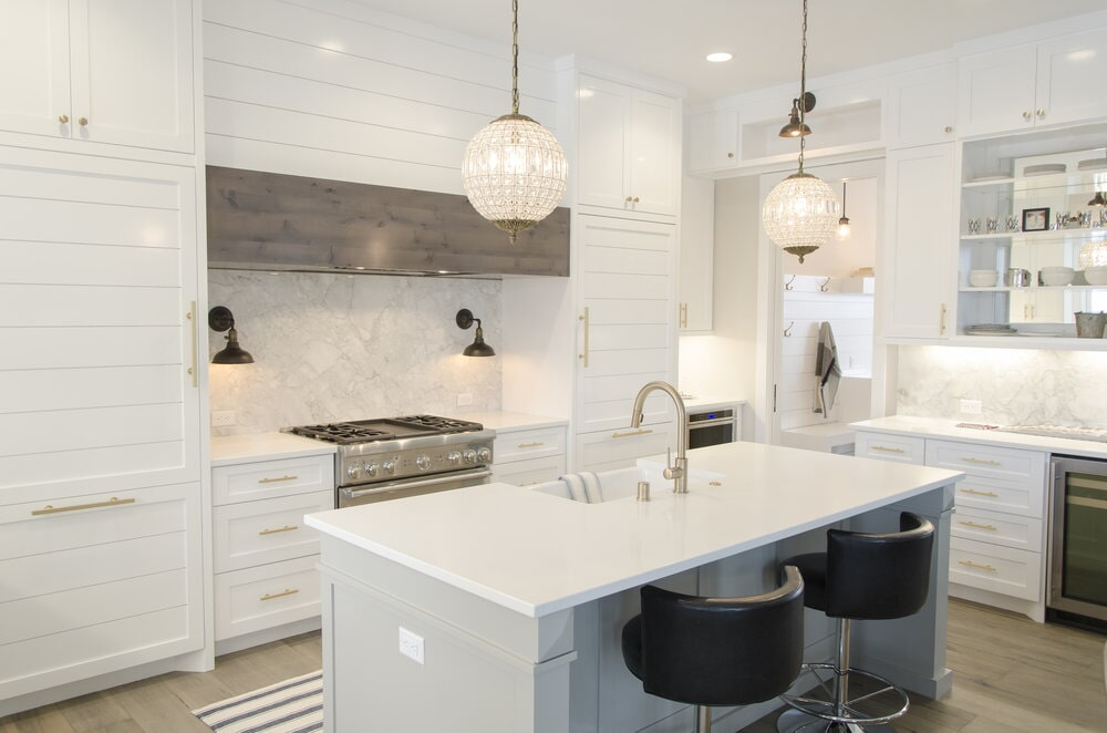 Beautiful white cabinetry in custom kitchen in Lake Norman, NC from LITTLE Wood Flooring & Cabinetry