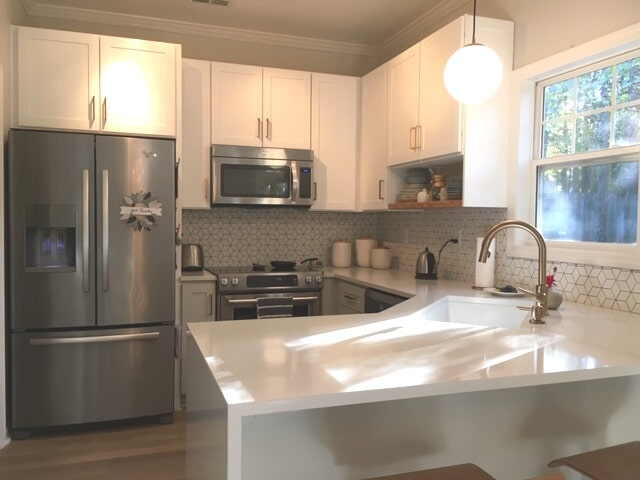 Beautiful white kitchen with stainless steel appliances in Mooresville, NC