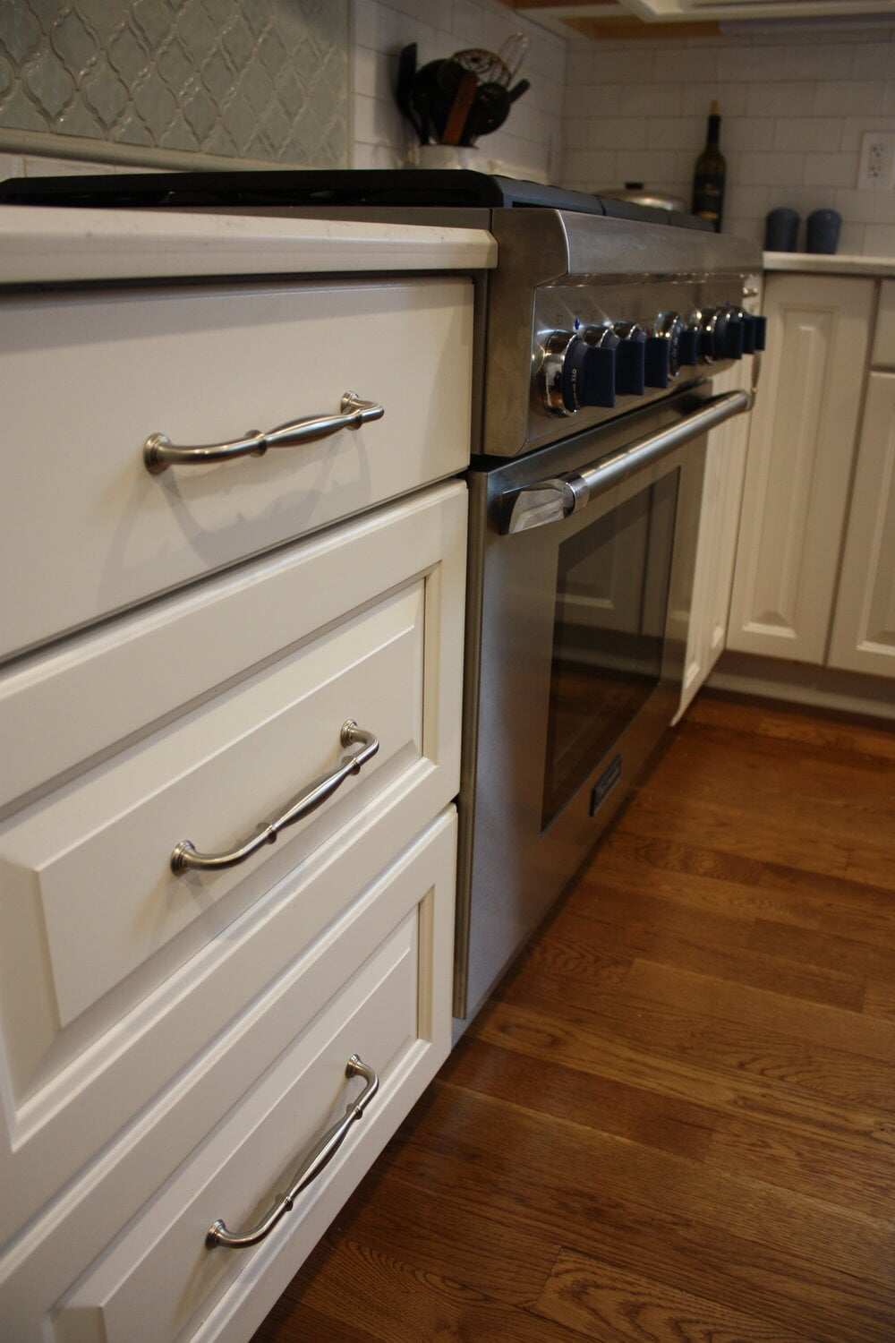 Kitchen with white cabinets and wood floors in Cornelius, NC from LITTLE Wood Flooring & Cabinetry