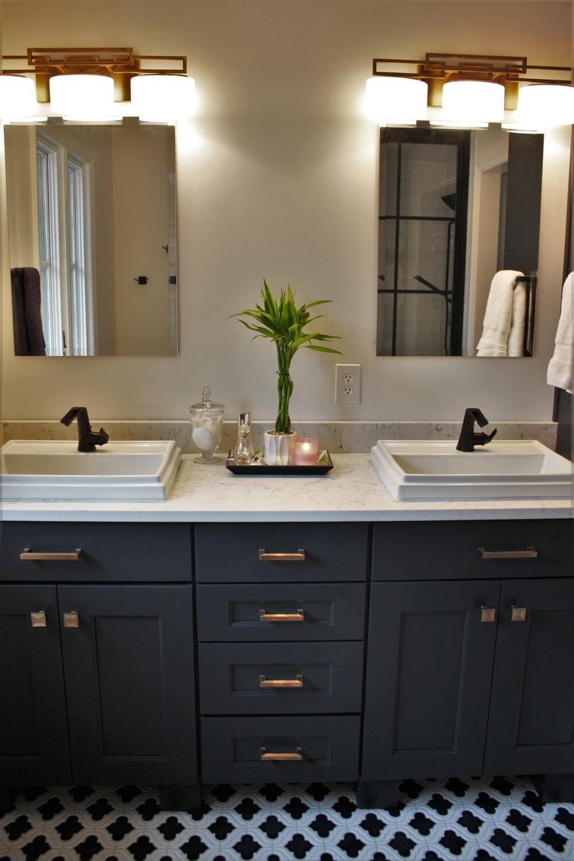 Custom bathroom remodel with black and white tile flooring in Cornelius, NC