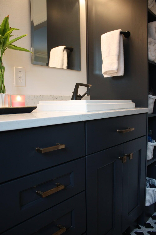 Beautiful blue vanity with white stone counters in Cornelius, NC