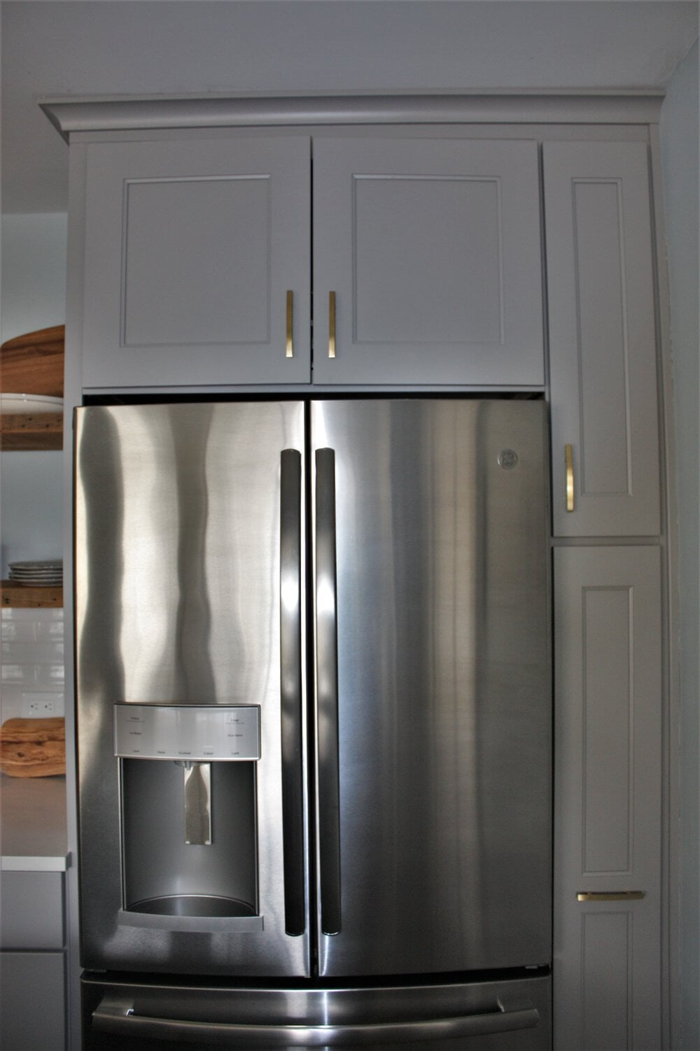 Custom cabinetry around fridge in Huntersville, NC from LITTLE Wood Flooring & Cabinetry