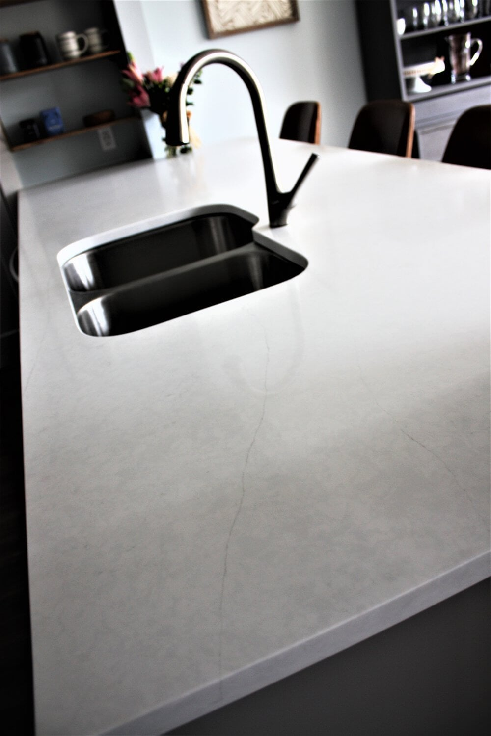 Custom kitchen island with built-in sink in Davidson, NC from LITTLE Wood Flooring & Cabinetry