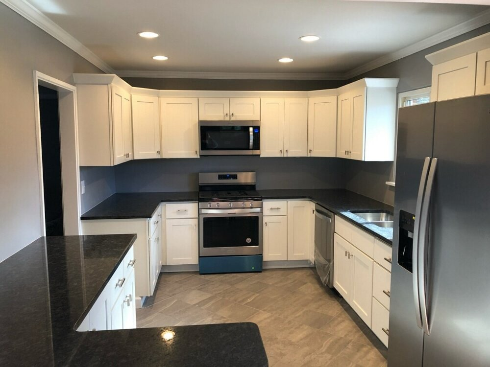 Modern kitchen with black and white design in Mooresville, NC from LITTLE Wood Flooring & Cabinetry