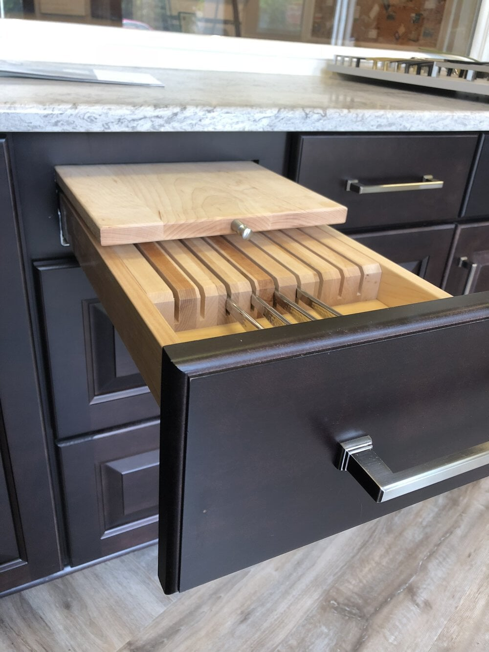 Kitchen cabinet drawer with custom knife rack in Cornelius, NC from LITTLE Wood Flooring & Cabinetry