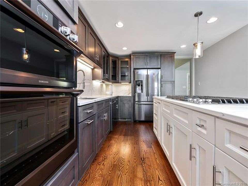 Bright kitchen island with dark cabinets in Mooresville, NC from LITTLE Wood Flooring & Cabinetry