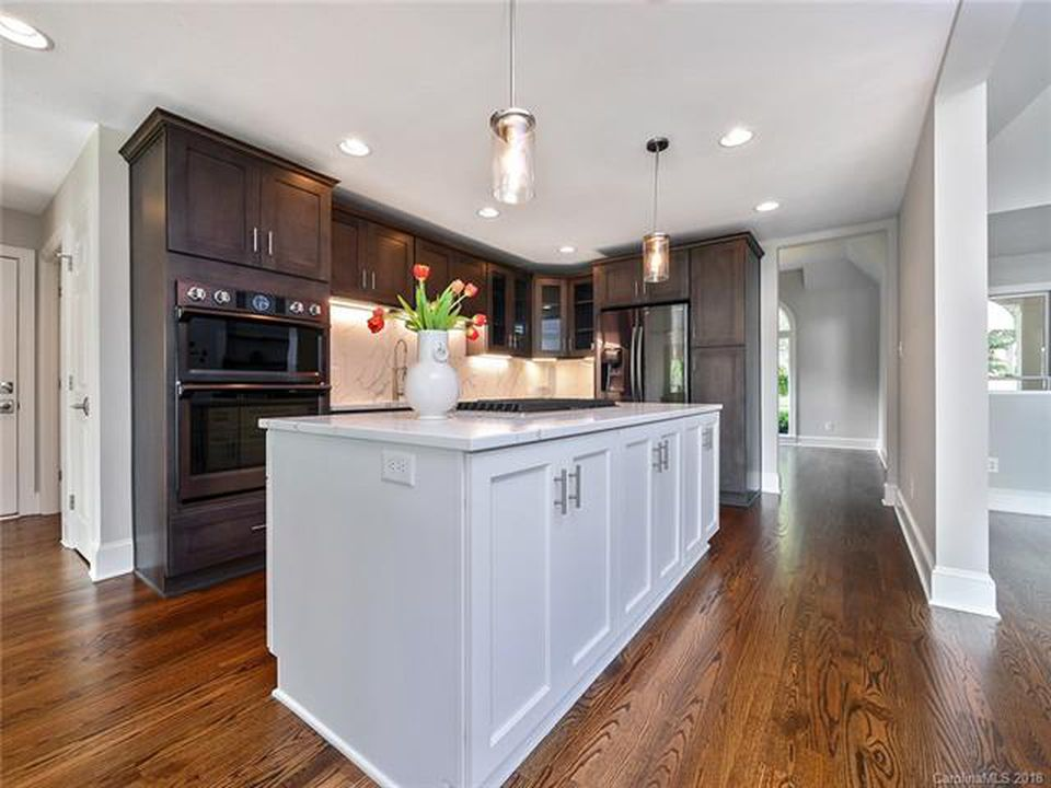 Gray kitchen island with dark wood cabinets in Mooresville, NC from LITTLE Wood Flooring & Cabinetry
