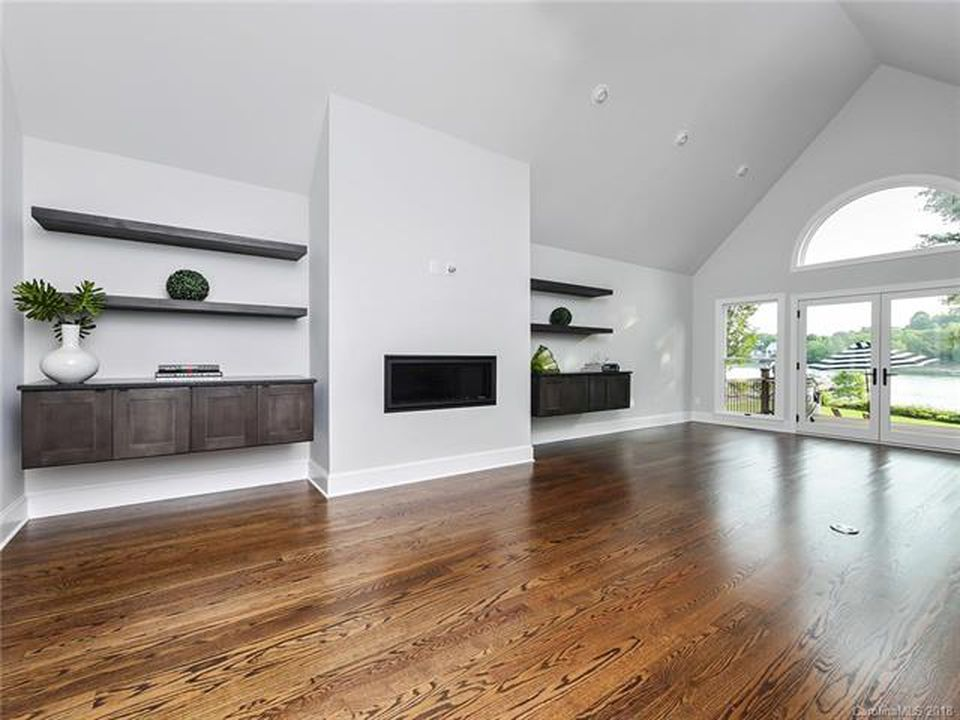 Modern living space with natural wood flooring in Huntersville, NC