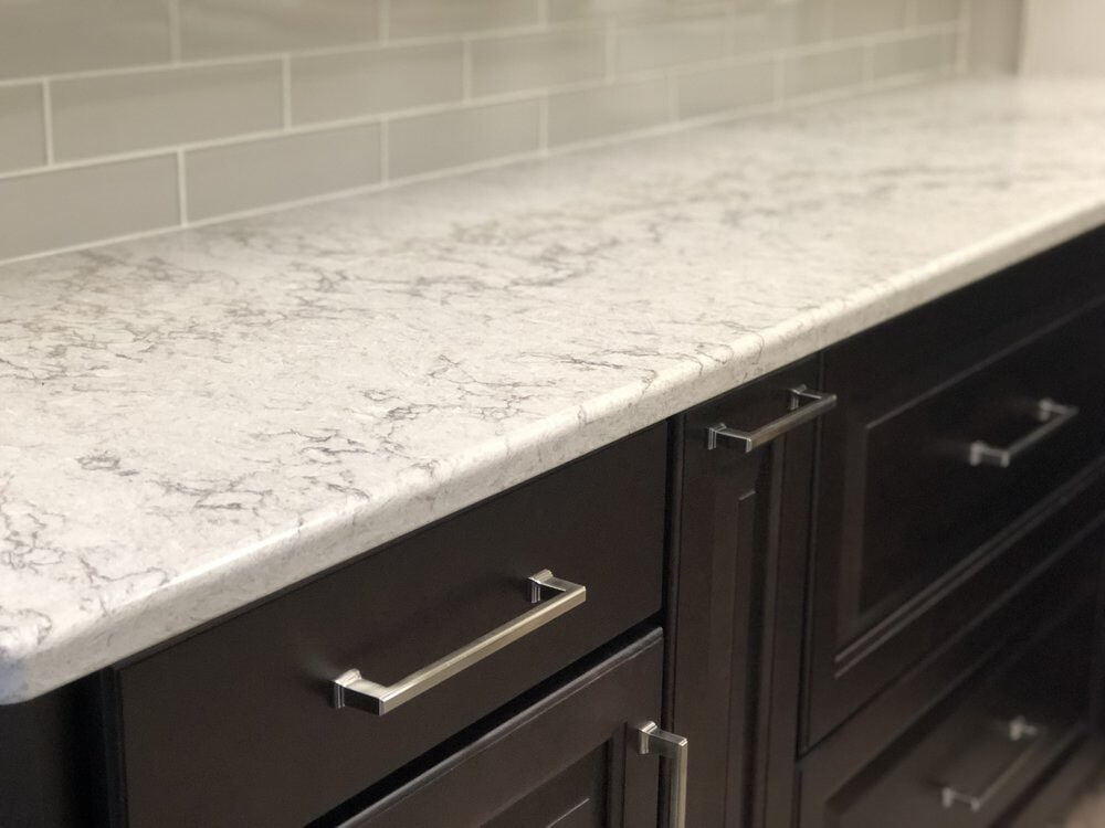 Dark cabinets with white granite countertop in Lake Norman, NC from LITTLE Wood Flooring & Cabinetry