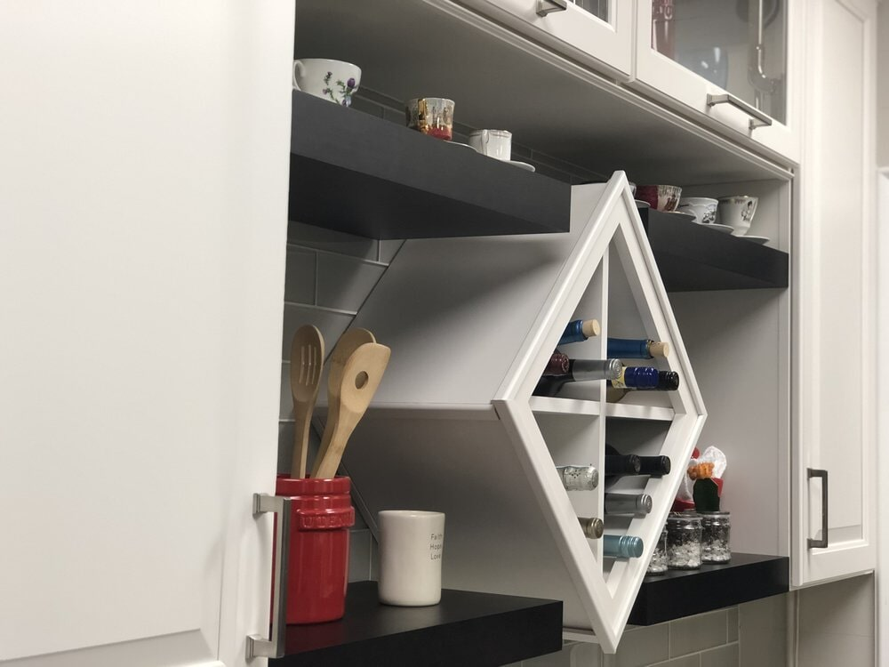 Custom built-in wine shelf in kitchen renovation in Mooresville, NC from LITTLE Wood Flooring & Cabinetry