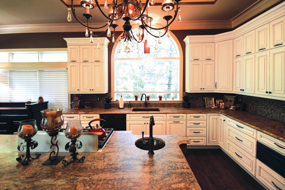 Custom kitchen island with sink and range in Huntersville, NC from LITTLE Wood Flooring & Cabinetry