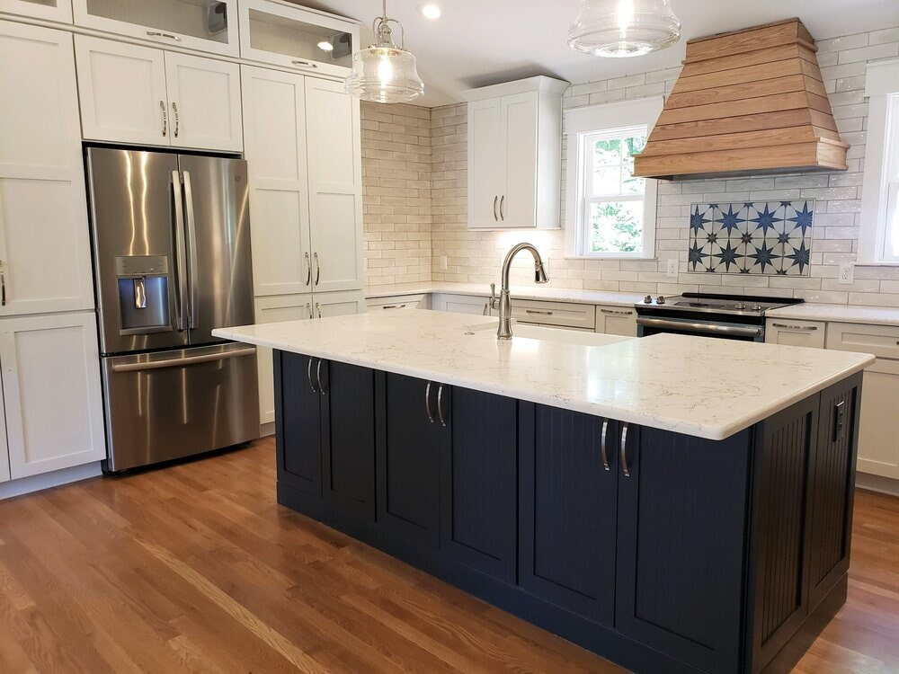 Blue island with white kitchen cabinets in Cornelius, NC from LITTLE Wood Flooring & Cabinetry
