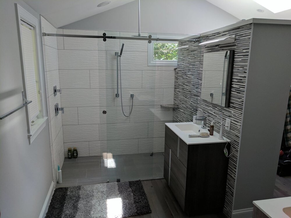 Custom textured tile shower with glass tile accents in Mooresville, NC from LITTLE Wood Flooring & Cabinetry