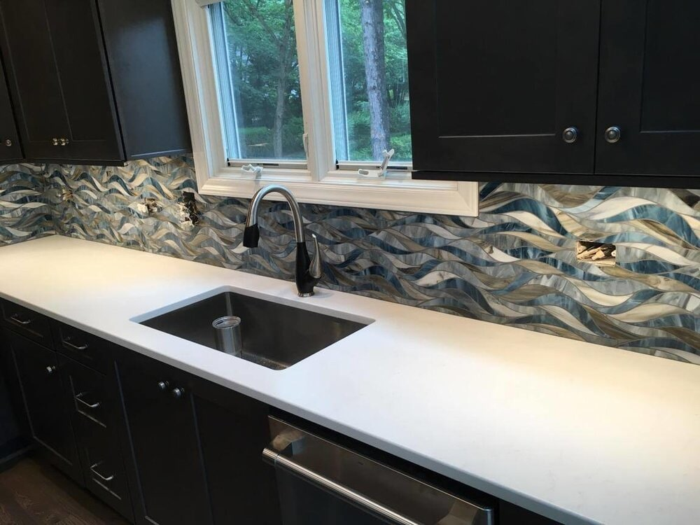Beautiful stained glass look backspash in Huntersville, NC from LITTLE Wood Flooring & Cabinetry