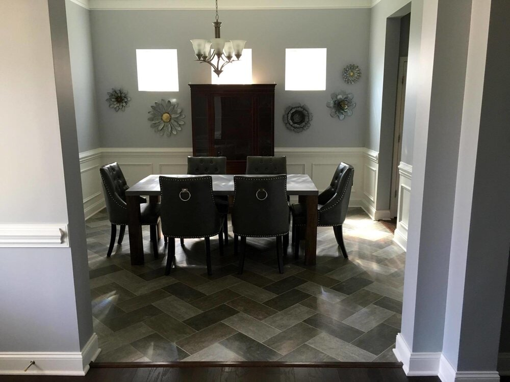Beautiful dining space with custom tile flooring in Davidson, NC from LITTLE Wood Flooring & Cabinetry
