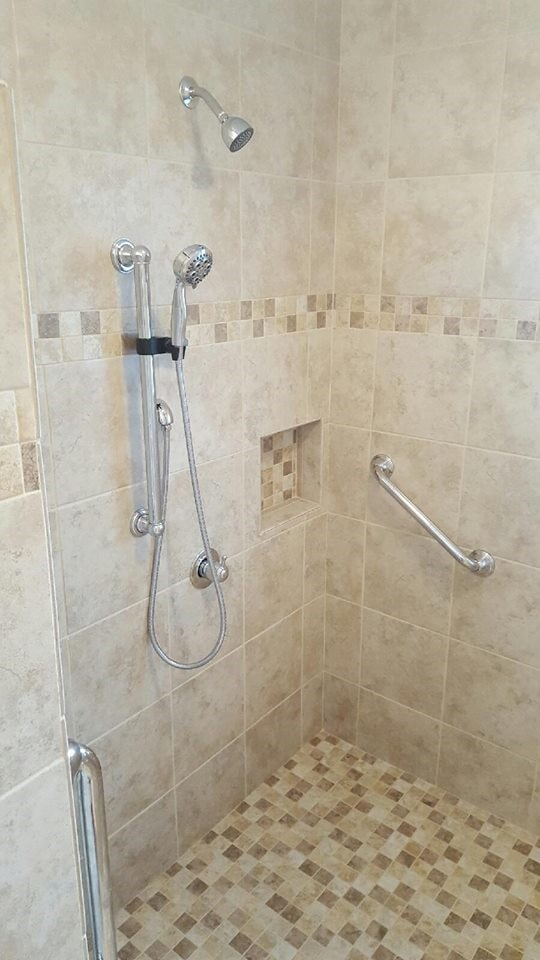Custom shower with recessed shelf in Lake Norman, NC from LITTLE Wood Flooring & Cabinetry