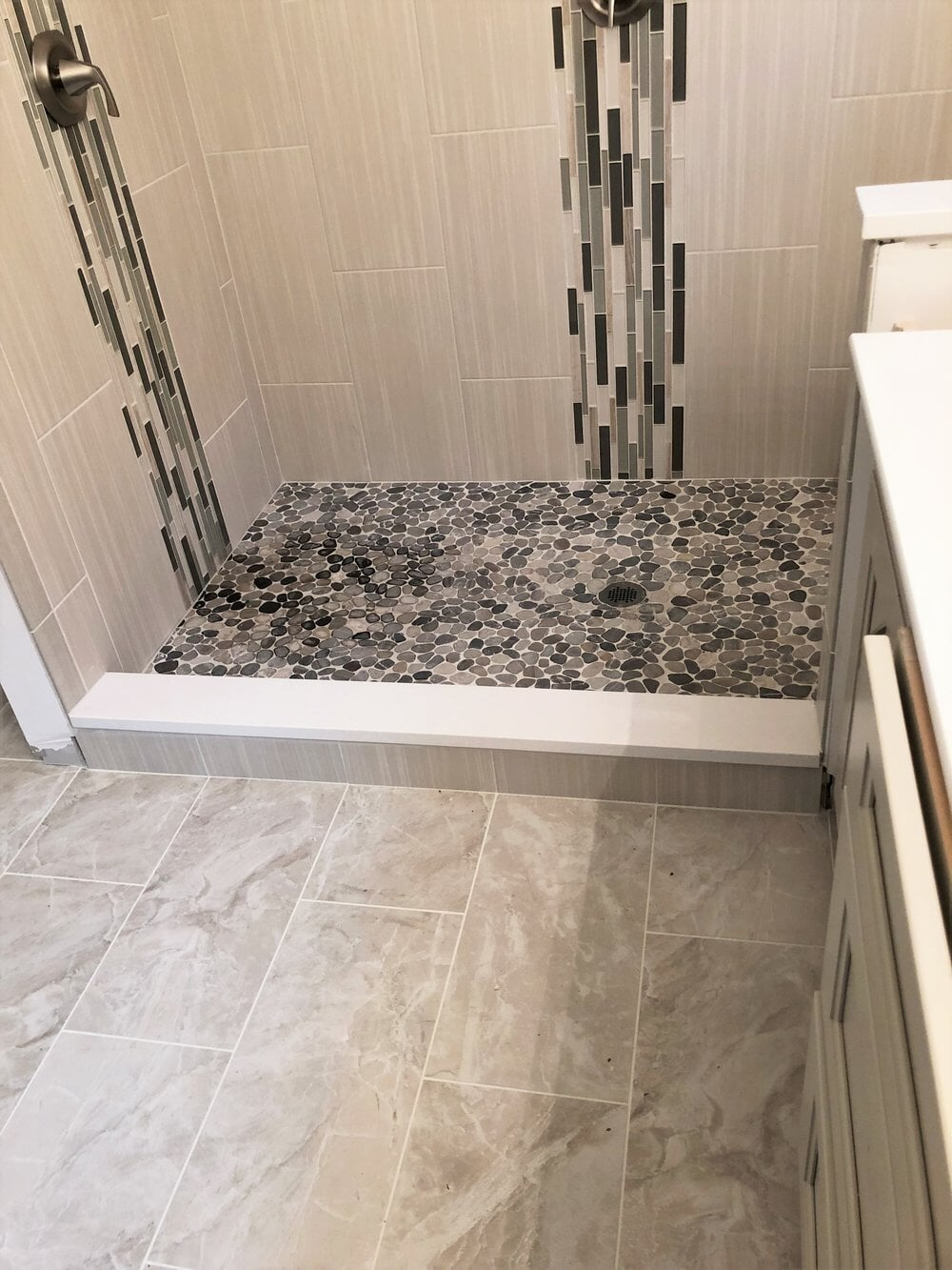 Custom glass tile work in new shower in Mooresville, NC from LITTLE Wood Flooring & Cabinetry