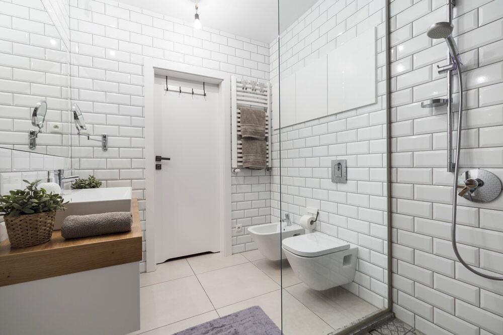 White subway tile bathroom walls in modern renovation in Huntersville, NC