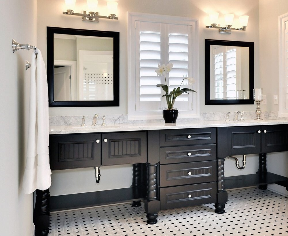Dark vanity with white counters and custom tile flooring in Davidson, NC