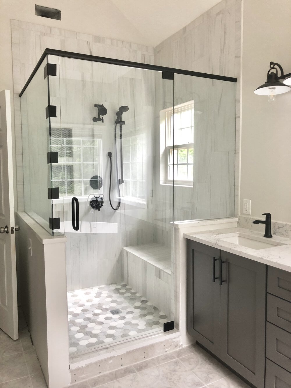 Custom shower with built-in bench in Davidson, NC from LITTLE Wood Flooring & Cabinetry
