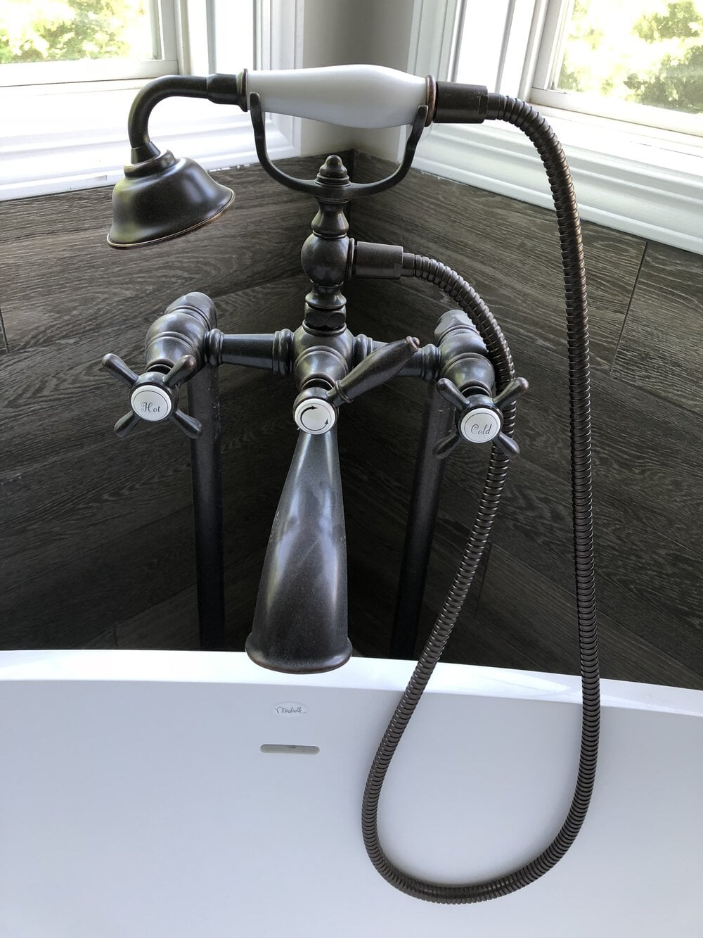 Soaking tub faucet with sprayer in Davidson, NC from LITTLE Wood Flooring & Cabinetry