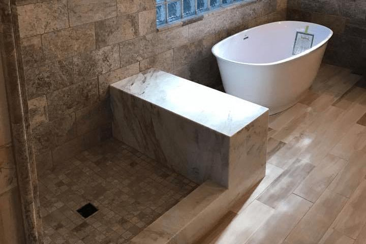 Beautiful custom bench and soaking tub in Sun City, AZ from Cornerstone Flooring Brokers