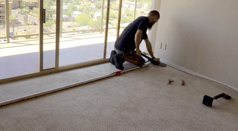 A member of our professional team installing flooring in Peoria, AZ