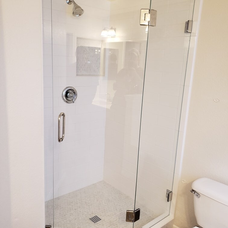 Bright shower renovation in Phoenix, AZ from Cornerstone Flooring Brokers