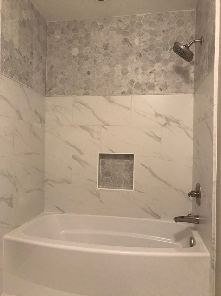 Shower installation with white stone and hexagonal tile accents in Scottsdale, AZ