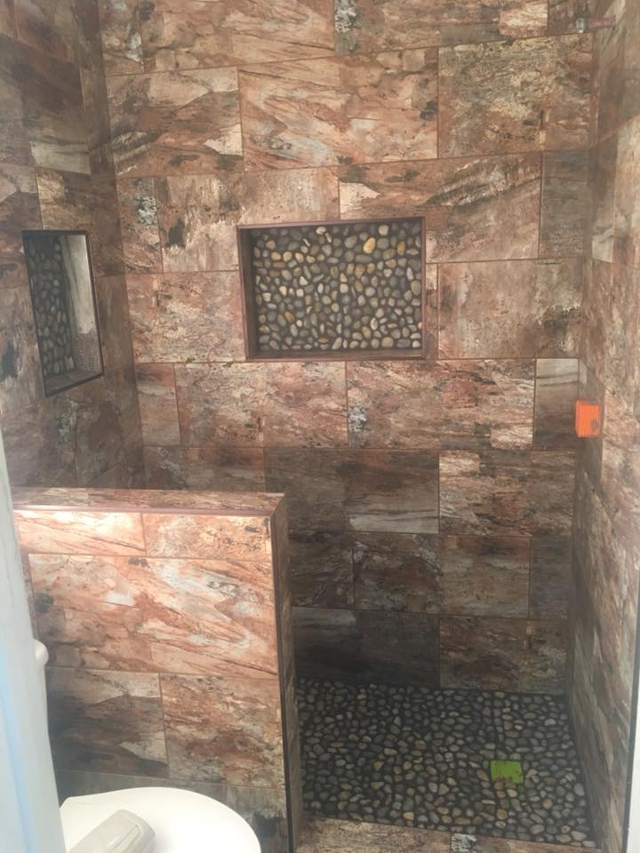 Beautiful round stone accents in shower installation in Peoria, AZ