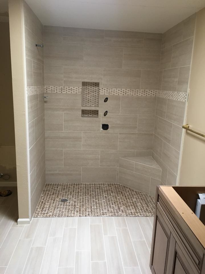 Shower installation with custom accents in Phoenix, AZ from Cornerstone Flooring Brokers