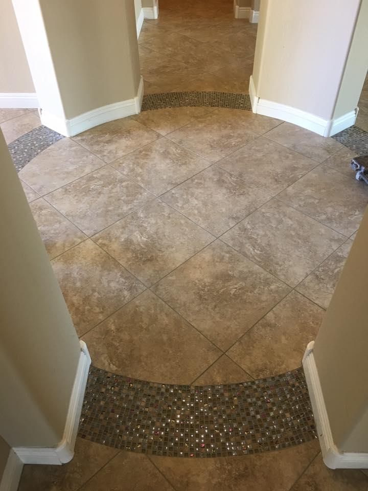 Custom tile work in entryway in Scottsdale, AZ from Cornerstone Flooring Brokers