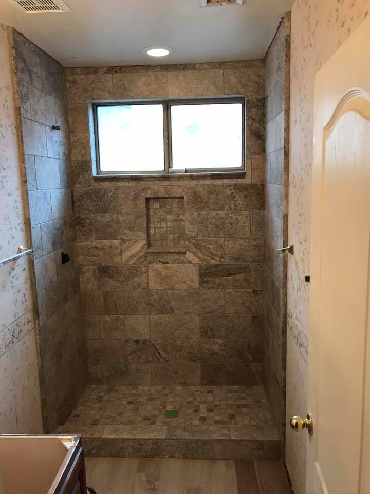 Natural tone shower installation in Phoenix, AZ from Cornerstone Flooring Brokers