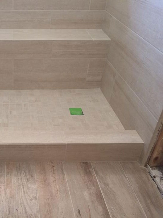 Shower installation with built in bench in Sun City, AZ from Cornerstone Flooring Brokers
