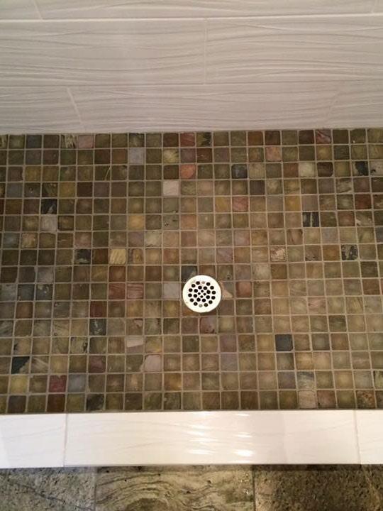 Custom natural tile shower floor in Glendale, AZ from Cornerstone Flooring Brokers