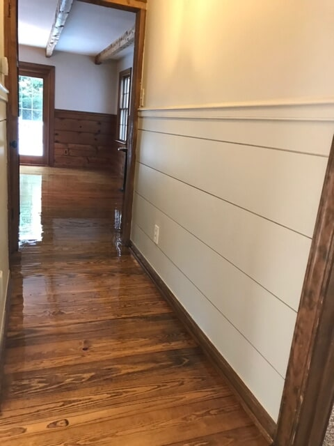 Glossy refinish on hardwood floor covering in Lawrenceville, GA from Delta Carpet & Decor